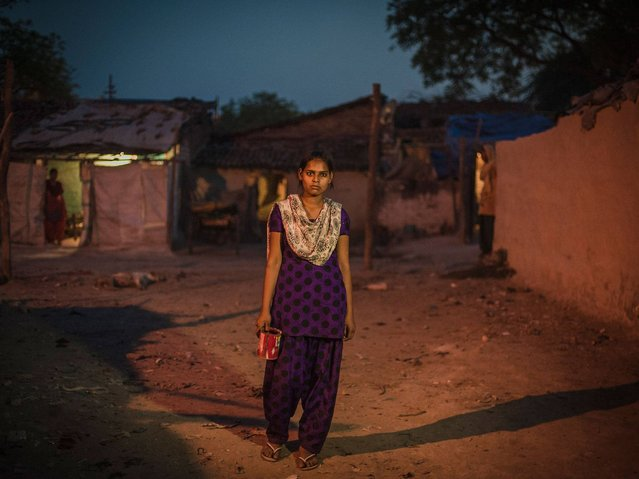 Some 300 girls and women in India still practise open defecation. Over half the country's population, 800 million people, do not have access to a toilet that meets basic standards. (Photo by Poulomi Basu/WaterAid)