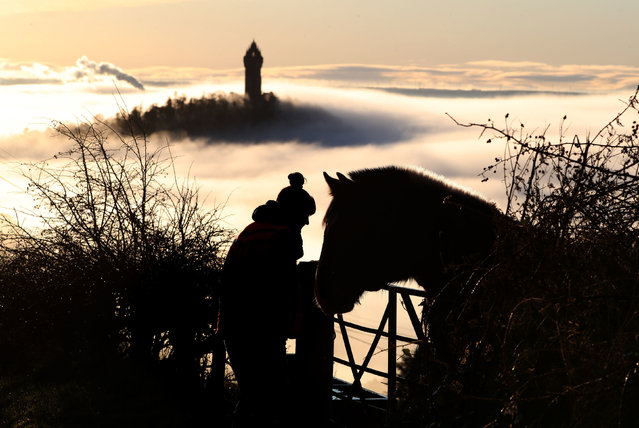 The Wallace Monument is shrouded in fog as it floats through the Carse of Stirling on Christmas morning in Scotland on December 25, 2019. (Photo by Andrew Milligan/PA Images via Getty Images)