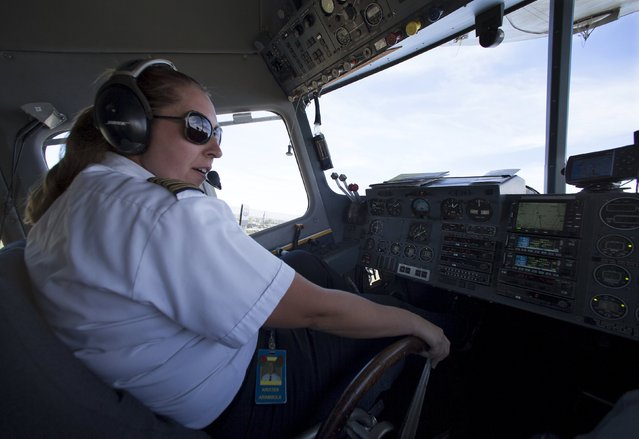 """One of only three active female blimp pilots in the world, Kristen Arambula  takes off as she pilots the Goodyear blimp """"Spirit of America"""" from Carson, California August 5, 2015. (Photo by Mike Blake/Reuters)"""