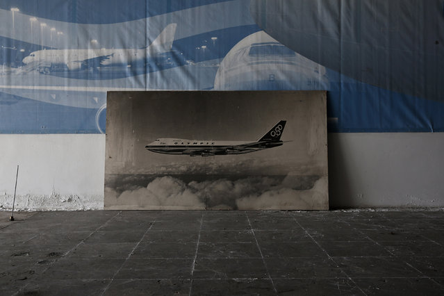 A photograph of an Olympic Airways aircraft is seen inside a hall which was used as a museum for the carrier, after the closure of the Hellenikon airport south of Athens June 16, 2014. (Photo by Yorgos Karahalis/Reuters)