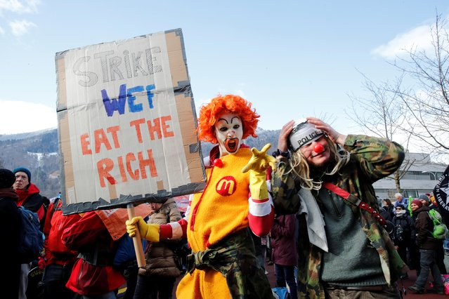 Protesters wearing costumes attend a demonstration against the World Economic Forum (WEF), which begins on January 21, in the town of Landquart, Switzerland January 19, 2020. (Photo by Arnd Wiegmann/Reuters)