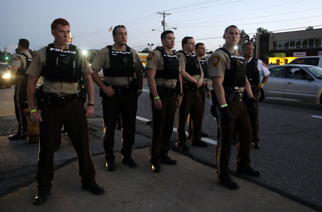 Police patrol on Monday, August 10, 2015, in Ferguson, Mo. (Photo by Jeff Roberson/AP Photo)