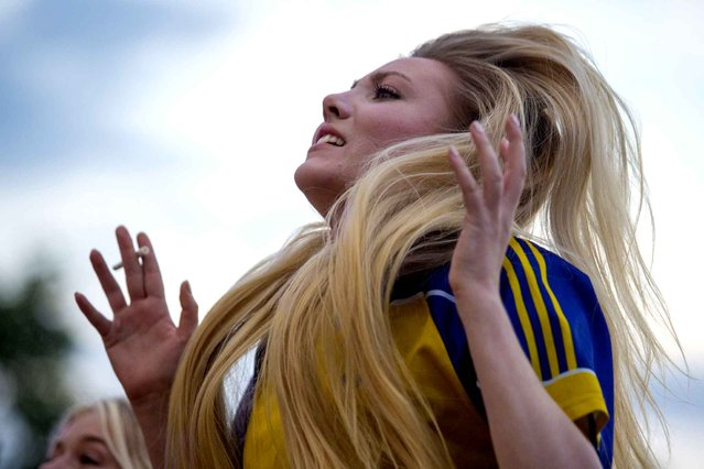 A Sweden fan reacts as she watches the Euro 2016 group E football match between Sweden and Belgium on a giant screen at the fanzone near the Eiffel Tower in Paris on June 22, 2016. (Photo by Geoffroy van der Hasselt/AFP Photo)