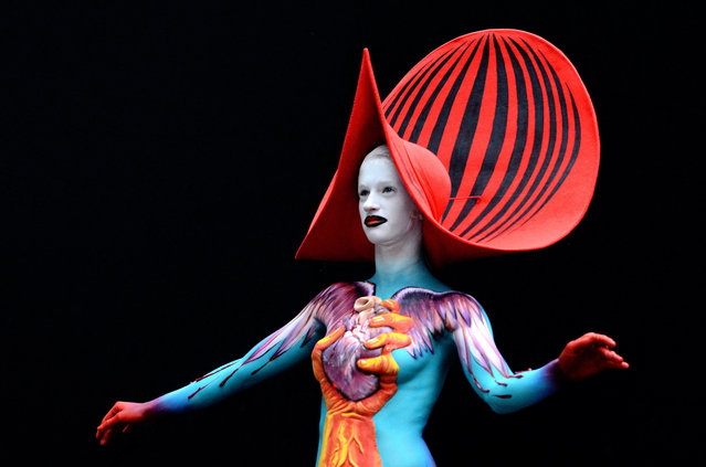 A model poses with her bodypainting designed by bodypainting artist Gergely Lengyel from Hungary, in the 2016 World Bodypainting Festival 2016 on July 3, 2016 in Poertschach am Woerthersee, Austria. (Photo by Didier Messens/Getty Images)