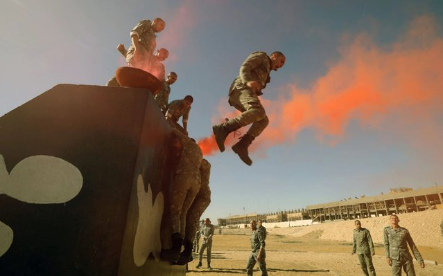Egyptian police students perform in a training session at a police academy in Cairo, Egypt, 30 December 2019. The Police Academy offers a four-year program which includes security administration, criminal investigation, military drills, civil defense, fire fighting, forensic medicine, communications, cryptology, first aid, sociology, anatomy, French and English as foreign languages, political orientation, public relations, marksmanship, leadership, and field exercises. Graduates receive a bachelor of police studies degree and are commissioned first lieutenants. (Photo by Khaled Elfiqi/EPA/EFE/Rex Features/Shutterstock)