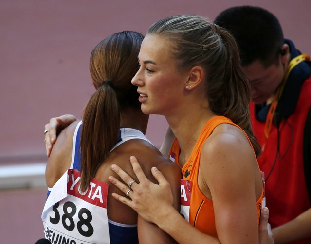 Jessica Ennis-Hill of Britain (L) congratulates Nadine Visser of Netherlands for winning 100 metres hurdles heats 4 of the women's heptathlon during the 15th IAAF World Championships at the National Stadium in Beijing, China August 22, 2015. (Photo by David Gray/Reuters)