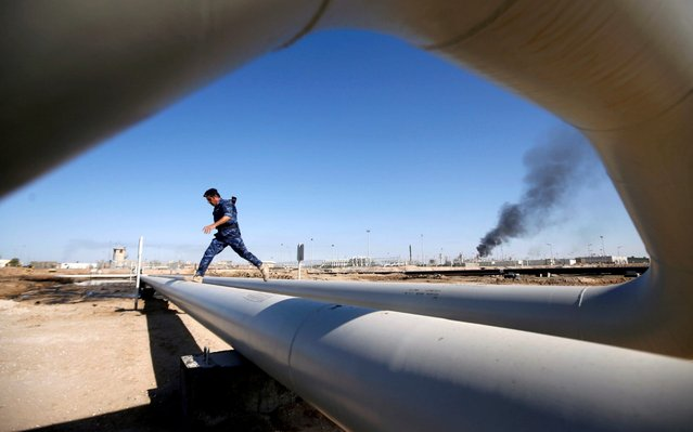 A policeman walks at West Qurna-1 oil field, which is operated by ExxonMobil, in Basra, Iraq, January 9, 2020. (Photo by Essam al-Sudani/Reuters)