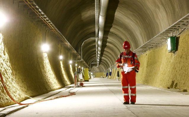 A worker stands in a side tunnel of the NEAT Gotthard Base Tunnel during a media visit near the town of Sedrun August 24, 2015. (Photo by Arnd Wiegmann/Reuters)