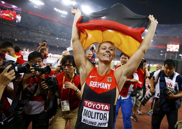 Kathrina Molitor of Germany celebrates after winning gold in the women's javelin throw final during the 15th IAAF World Championships at the National Stadium in Beijing, China August 30, 2015. (Photo by Kai Pfaffenbach/Reuters)