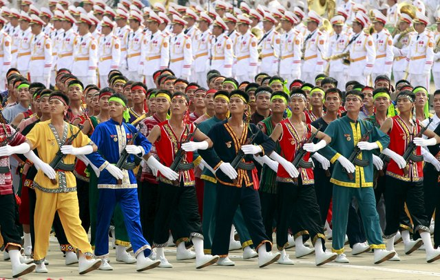Male members of ethnic minorities militia force march during a parade marking their 70th National Day at Ba Dinh square in Hanoi, Vietnam September 2, 2015. (Photo by Reuters/Kham)