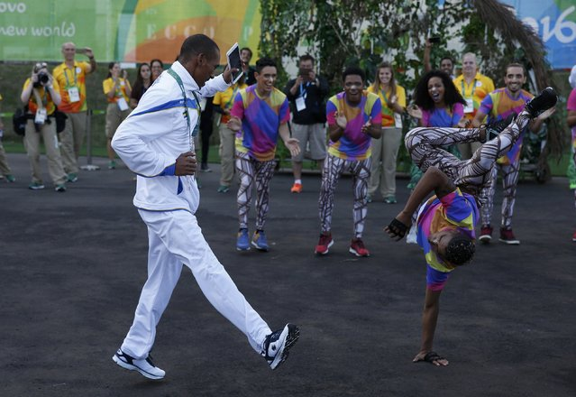 2016 Rio Olympics, Olympic Village, Rio de Janeiro, Brazil on July 30, 2016. An athlete of Gabon dances during their official welcome ceremony. (Photo by Athit Perawongmetha/Reuters)