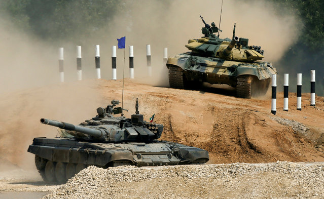 T-72 tanks, operated by crews from Kuwait (front) and Nicaragua, drive during the Tank Biathlon competition, part of the International Army Games 2016, at a range in the settlement of Alabino outside Moscow, Russia, August 2, 2016. (Photo by Maxim Shemetov/Reuters)
