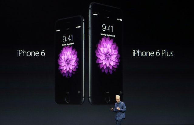 Apple CEO Tim Cook introduces the new iPhone 6 and iPhone 6 Plus on Tuesday, September 9, 2014, in Cupertino, Calif. (Photo by Marcio Jose Sanchez/AP Photo)