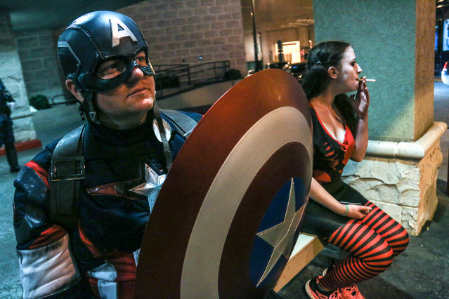 In this Saturday, September 5, 2015, photo, a man attending Dragon Con and dressed as Captain America takes a break outside his hotel in Atlanta. (Photo by Ron Harris/AP Photo)