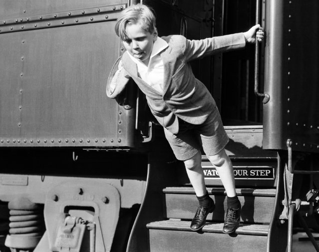 Jackie Cooper, the child actor, photographed as he arrived back home in Hollywood, Calif., June 2, 1932, after a stage tour in the East. (Photo by AP Photo)