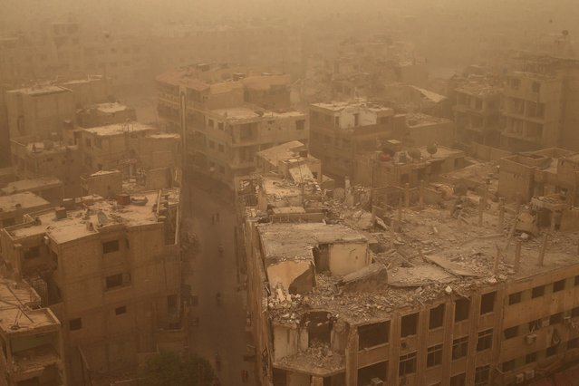Damaged buildings are pictured during a sandstorm in the Douma neighbourhood of Damascus, Syria September 7, 2015. (Photo by Bassam Khabieh/Reuters)