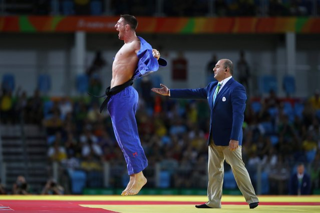 Lukas Krpalek of the Czech Republic celebrates after defeating Elmar Gasimov of Azerbaijan during the men's 100kg gold medal judo contest on Day 6 of the 2016 Rio Olympics at Carioca Arena 2, August 11, 2016. (Photo by  Julian Finney/Getty Images)