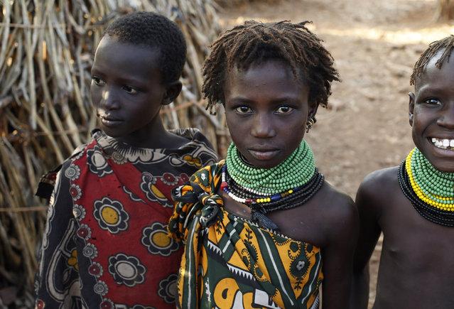 Turkana children stand by a hut in Napak village in northwestern Kenya inside the Turkana region of the Ilemy Triangle September 25, 2014. (Photo by Goran Tomasevic/Reuters)
