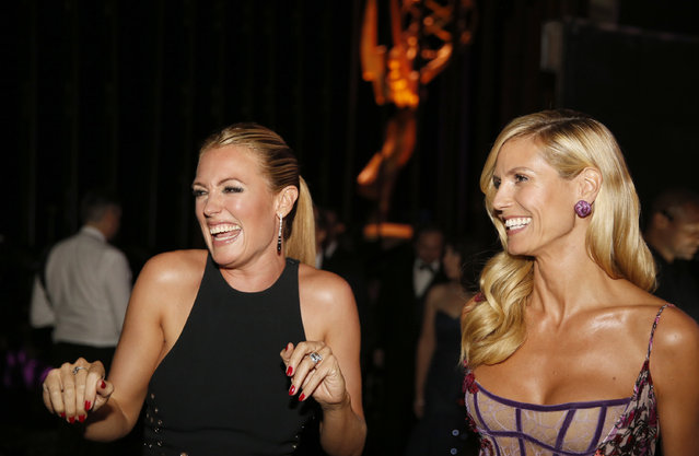 Cat Deely, left, and Heidi Klum seen backstage at the Television Academy's Creative Arts Emmy Awards at Microsoft Theater on Saturday, September 12, 2015, in Los Angeles. (Photo by Colin Young-Wolff/Invision for the Television Academy/AP Images)