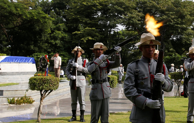 A soldier fires his rifle during a gun salute as Philippine President Rodrigo Duterte salutes at a National Heroes Day commemoration at the Libingan ng mga Bayani (Heroes' Cemetery) in Taguig city, Metro Manila in the Philippines August 29, 2016. (Photo by Erik De Castro/Reuters)