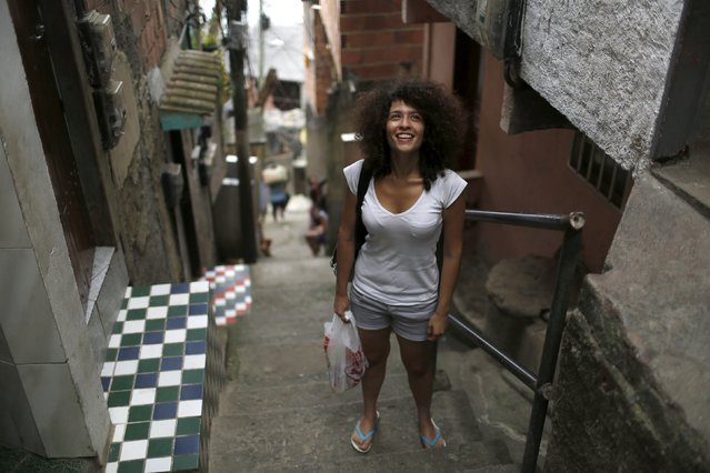 Syrian Tulin Hashemi poses for a photo along the street she is living in, at the Vidigal slum in Rio de Janeiro, Brazil, September 22, 2015. (Photo by Pilar Olivares/Reuters)