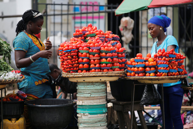 Women arrange produce for sale at a roadside market in Ojodu district in Nigeria's commercial capital Lagos August 19, 2016. (Photo by Akintunde Akinleye/Reuters)
