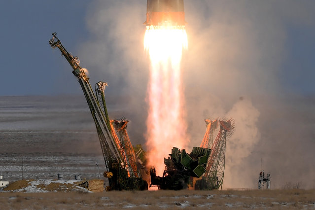 Russia's Soyuz MS-07 spacecraft carrying members of the International Space Station (ISS) expedition 54/55 blasts off to the ISS from the launch pad at the Russian-leased Baikonur Cosmodrome on December 17, 2017. The three-man space crew featuring NASA astronaut Scott Tingle and crewmates Anton Shkaplerov of the Russian space agency Roscosmos and Norishege Kanai of the Japan Aerospace Exploration Agency blasted off on December 17 for a six-month mission at the International Space Station. (Photo by Kirill Kudryavtsev/AFP Photo)