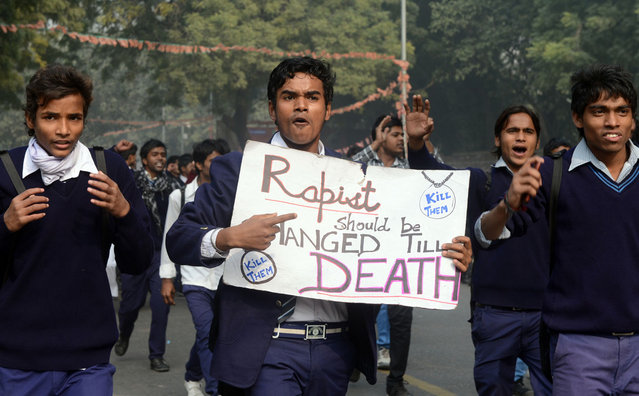 Demonstrating Indian school students hold placards as they shout anti-government slogans during a protest calling for better safety for women following the rape of a student in New Delhi on December 24, 2012. (Photo by Raveendran/AFP Photo)