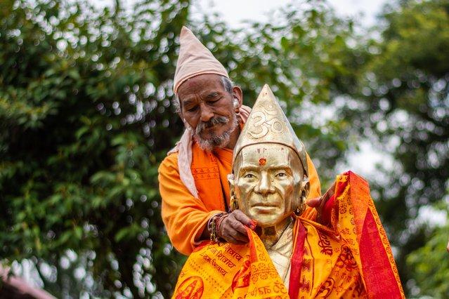 Hindu Disciple worship their guru Naraharinath on the occasion of Guru purnima or full moon day dedicated to the Guru or masters in one's life at Gorakhnath Temple in Pashupatinath, Kathmandu on Sunday, July 05, 2020. (Photo by Rojan Shrestha/NurPhoto via Getty Images)