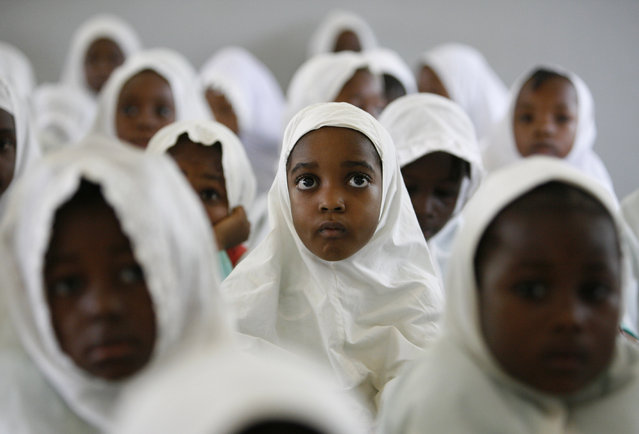 Students attend an Arabic class at the Al-Haraiman French-Arabic School in Yaounde, Cameroon Monday, March 16, 2009. (Photo by Rebecca Blackwell/AP Photo)