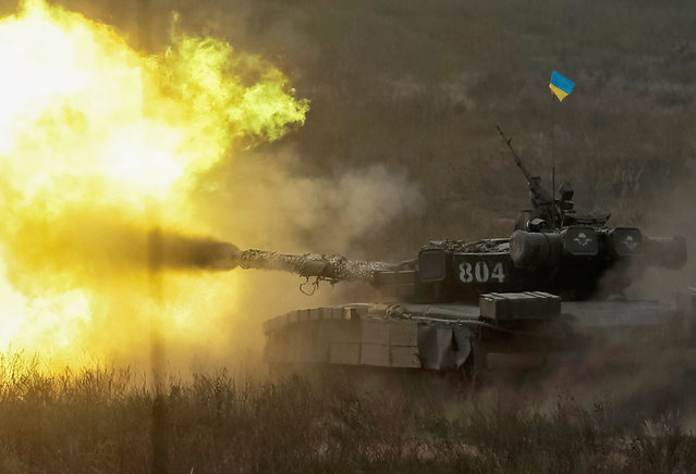 A tank fires during a military exercise in the training centre of Ukrainian Ground Forces near Goncharivske in Chernihiv region, Ukraine, September 10, 2016. (Photo by Gleb Garanich/Reuters)