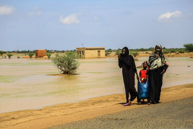 Sudanese people continue to struggle under difficult conditions in Al-Nezile village of East Nile State after the flood brought by the strong rains that were effective last week in the southeast of Khartoum, Sudan on August 08, 2020. (Photo by Mahmoud Hjaj/Anadolu Agency via Getty Images)