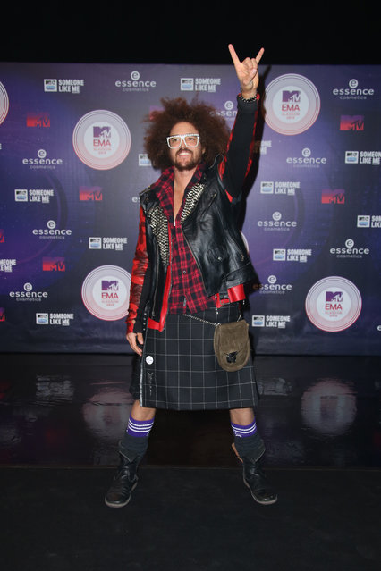 Musician Redfoo poses for photographers as he arrives for the 2014 MTV European Music Awards in Glasgow, Sunday, November 9, 2014. (Photo by Joel Ryan/Invision/AP Photo)