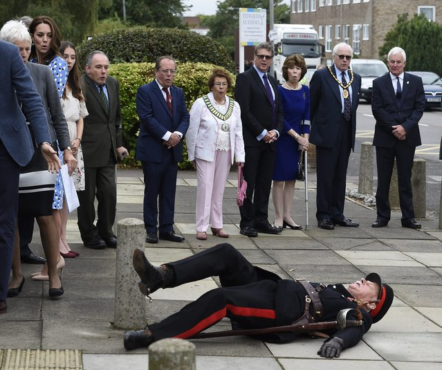 HRH Catherine, The Duchess of Cambridge (2-L) and others react after Jonathan Douglas-Hughes (C), OBE, Vice Lord-Lieutenant of Essex, tripped over a concrete bollard during the visit of the Duke and Duchess of Cambridge visit Stewards Academy in Harlow to the Stewards Academy in Harlow, Essex, Britain, 16 September 2016. (Photo by Facundo Arrizabalaga/EPA)