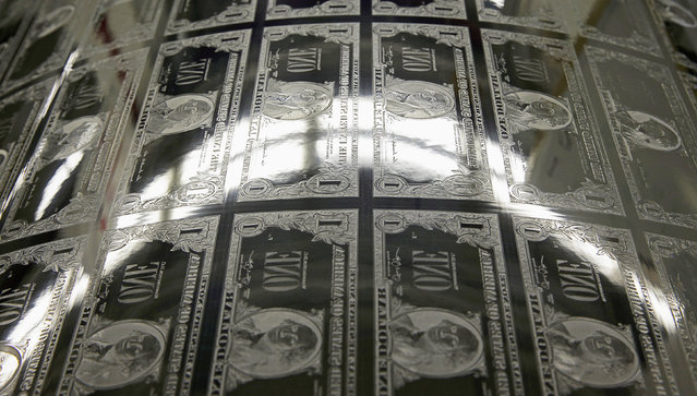 An engraving plate for one dollar bills is seen during production at the Bureau of Engraving and Printing in Washington November 14, 2014. (Photo by Gary Cameron/Reuters)