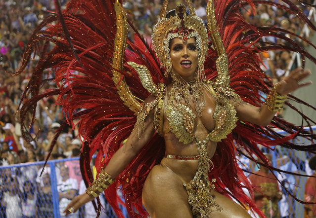 A reveller from Salgueiro performs during the second night of the Carnival parade at the Sambadrome in Rio de Janeiro, Brazil on February 13, 2018. (Photo by Sergio Moraes/Reuters)