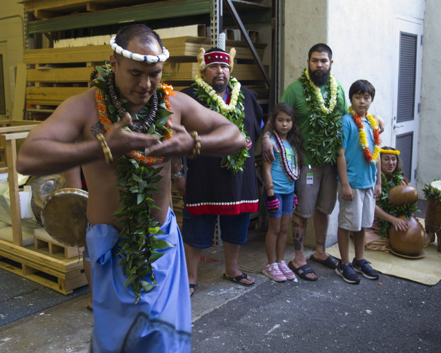 Hula dancer Okolani Tallett, left, dances for  members of the Alaskan Tlingit tribe at the Honolulu Museum of Arts, Thursday, October 22, 2015, in Honolulu. (Photo by Marco Garcia/AP Photo)