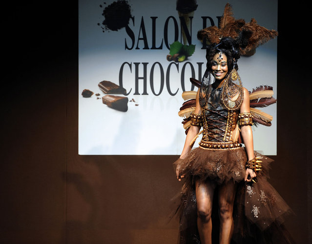 A model presents a dress made from chocolate during the second Bordeaux's Chocolate fair (Salon du Chocolat) on March 15, 2013, in Bordeaux, western France. (Photo by Jean-Pierre Muller/AFP Photo)