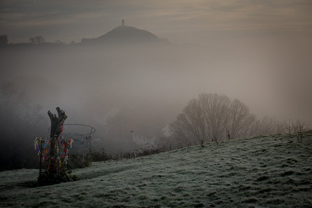 Mist and frost lingers in fields surrounding Glastonbury Tor as the winter sun begins to rise on November 24, 2014 in Somerset, England. Weather forecasters are predicting that the UK is set to see a significant drop in temperature this week bringing the first widespread frost of the season with temperatures dropping as low as -5C  (Photo by Matt Cardy/Getty Images)