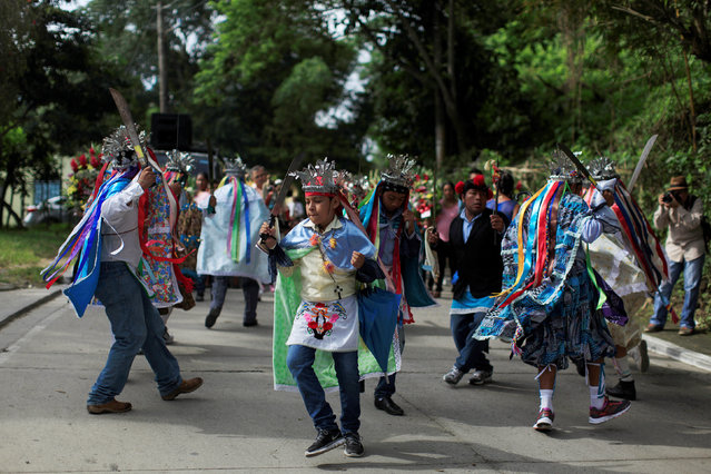 Participants perform the traditional dance of Los Historiantes during a procession on the festivities in honour of St. Michael the Archangel in San Miguel Tepezontes, El Salvador September 28, 2016. (Photo by Jose Cabezas/Reuters)