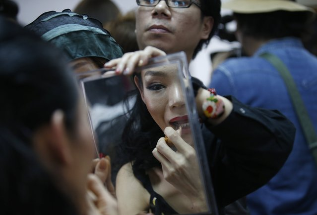 Contestant Yuko of Japan prepares backstage during the annual transgender beauty contest of Miss International Queen 2018 at Pattaya city, in Chonburi province, Thailand, 09 March 2018. (Photo by Narong Sangnak/EPA/EFE)