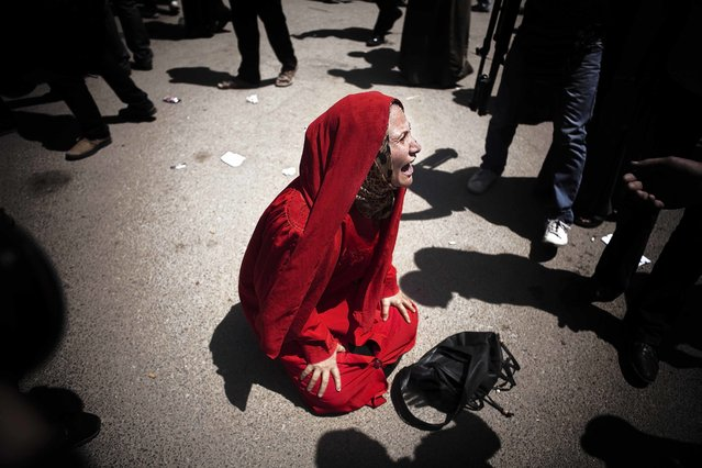 The mother of one of the young boys killed by the Army in Port Said reacts to In the parking lot outside the Police Academy, the crowd initially exploded with cries of joy and praying at news of Mr. Mubarak's life sentence, Egypt. (Photo by Maysun)