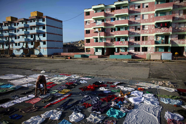 A man puts clothes to dry after the passage of Hurricane Matthew in Baracoa, Cuba October 7, 2016. (Photo by Alexandre Meneghini/Reuters)