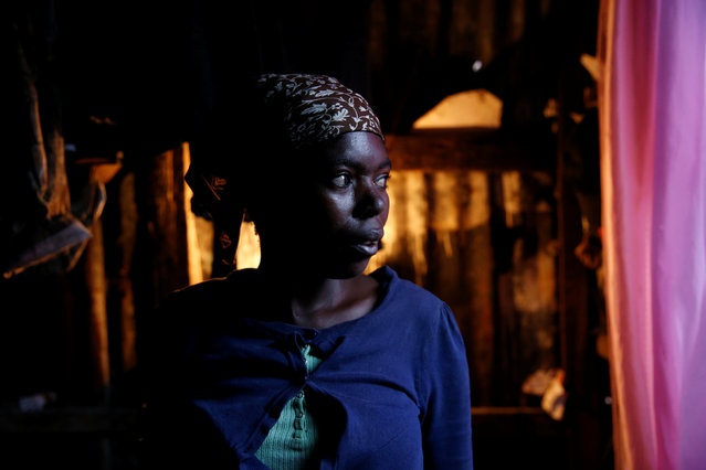 Isma Nadenje poses for a portrait inside her house, after Hurricane Matthew passes Cite-Soleil in Port-au-Prince, Haiti, October 5, 2016. (Photo by Carlos Garcia Rawlins/Reuters)