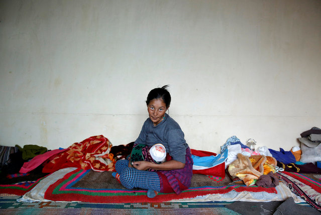 """Tsewang Lhadon, 36, a housewife, poses for a photograph in Choklamsar, a village nestled high in the Indian Himalayas, India September 27, 2016. When asked how living in the world's fastest growing major economy had affected life, she replied, """"The children get a better education and are eating more nutritious food because of the government subsidies"""". (Photo by Cathal McNaughton/Reuters)"""