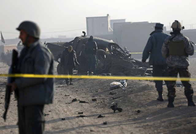 Afghan security forces inspect at the site of a suicide attack in Kabul December 18, 2014. One policeman was killed and two were injured on the outskirts of the Afghan capital on Thursday, in a blast caused by a suicide bomber attempting to enter Kabul in a vehicle laden with explosives, an interior ministry spokesman said. (Photo by Omar Sobhani/Reuters)