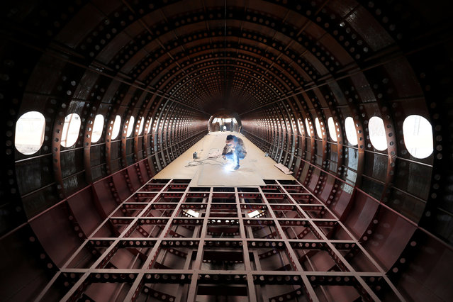 Zhu Yue welds inside a full-scale replica of the Airbus A320 plane that he and his friends are building, in Kaiyuan, Liaoning province, China April 3, 2018. (Photo by Sheng Li/Reuters)