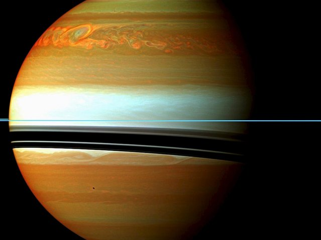 NASA handout image shows Saturn's atmosphere and its rings in a false color composite made from 12 images, captured in this January 12, 2011 file photo. (Photo by Reuters/NASA/JPL-Caltech/Space Science Institute)