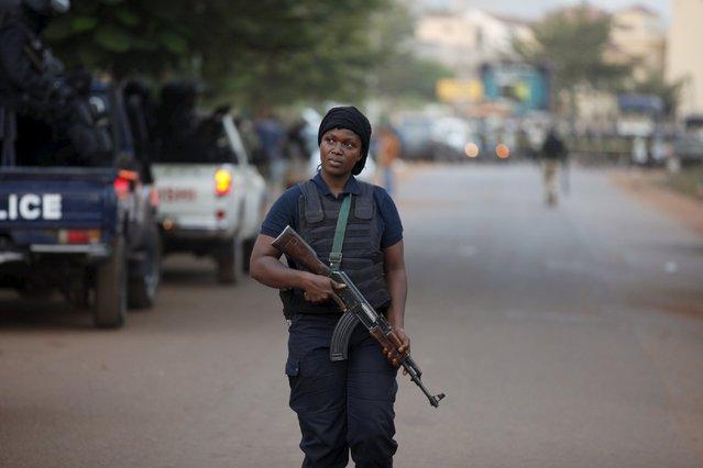 A Malian police officer walks in front of the Radisson hotel in Bamako, Mali, November 20, 2015. (Photo by Joe Penney/Reuters)