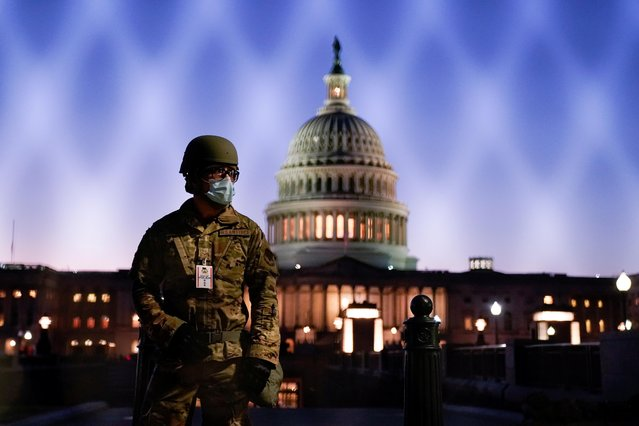 Members of the National Guard gather at the U.S. Capitol as the House of Representatives prepares to begin the voting process on a resolution demanding U.S. Vice President Pence and the cabinet remove President Trump from office, in Washington, U.S., January 12, 2021. (Photo by Erin Scott/Reuters)